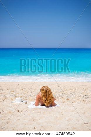 WOman on The famous Navagio Shipwreck beach in Zakynthos island Greece