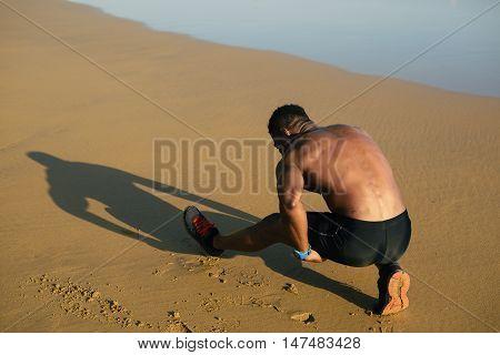 Runner Stretching Hamstring After Running