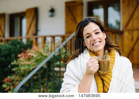 Relaxed Pensive Woman Outside Home On Autumn