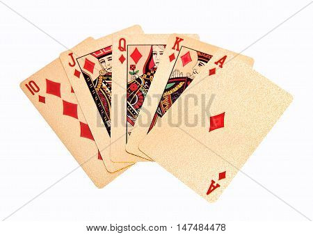 Royal straight flush golden playing cards poker hand in diamonds. On white background