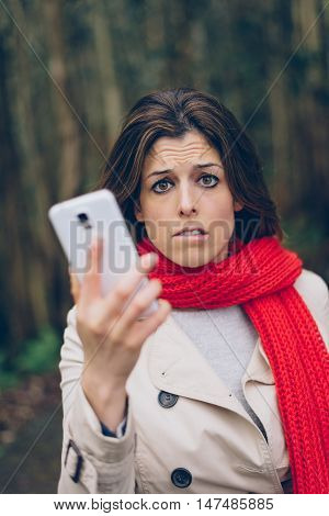 Worried Woman With Smartphone