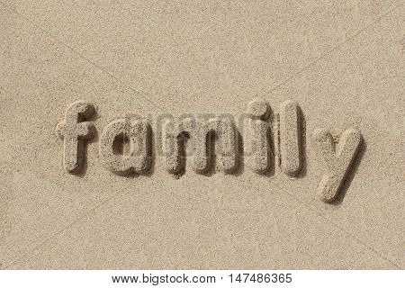 Family written in sand letters. Very simple and graphic.