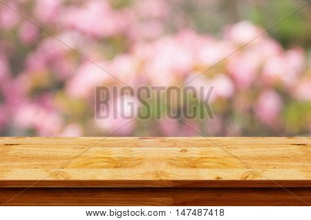 Empty wooden table with blurred pink background. For display or montage your products.