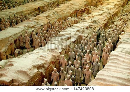 Xi'an China - September 7 2006: Soldiers in a silent procession at Pit #1 in the Museum of Terra Cotta Warriors of General Qin Shi Huang
