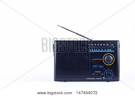old black vintage retro style AM, FM portable radio transistor receiver on white background  isolated