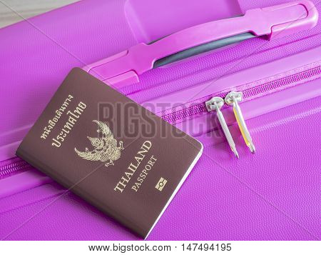 Closeup Thailand passport on pink suitcase (Travel Kits)