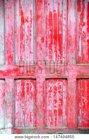 Background image shows old weathered wooden red door on train depot in Stoughton Wisconsin.