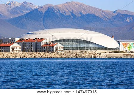 Sochi, Russia - NOVEMBER 8, 2014:  Luxury residential houses in Adler on a background of the Bolshoi Ice Palace in the Imereti lowland
