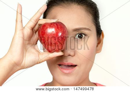 asian woman holding red apple in her hands