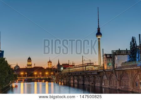 Twilight at the river Spree in Berlin with the TV Tower