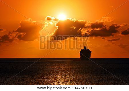 Cruise ship sailing into the sunset