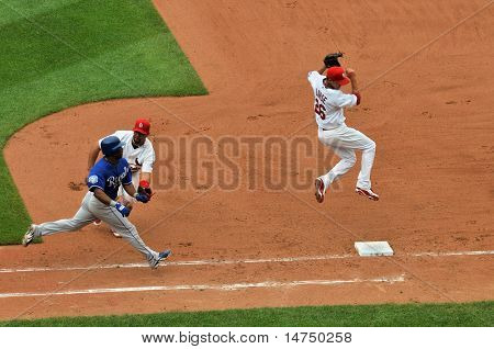 ST LOUIS - MAY 23: Albert Pujols of the Saint Louis Cardinals tags out Jose Guillen of  the Kansas City Royals at Busch Stadium in St. Louis, MO on May 23, 2009