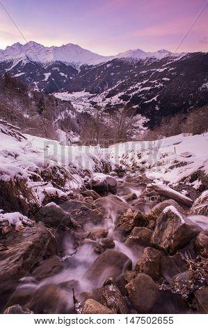 A small mountain stream tumbles down a Swiss hillside near Verbier Switzerland.