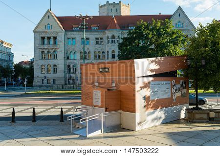 Poznan POLAND - September 06 2016: Encryption Container - temporary pavilion which looks like Enigma machine and stands at Sw. Marcin street in Poznan - in front of the Imperial Castle