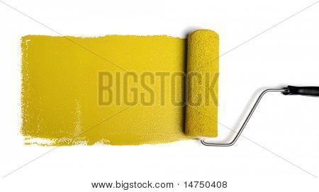 Paint roller leaving stroke of yellow paint over a white background