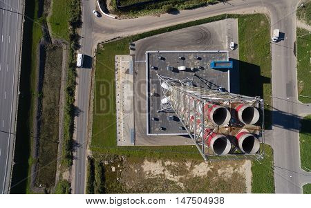 Aerial view of new modern gas boiler-house near the road track, district heating plant chimney, modular boiler. St. Petersburg, Russia, 2016