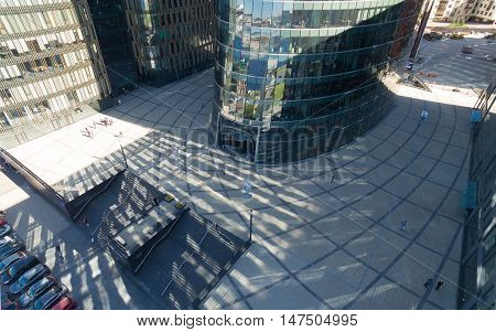 aerial view of business center and the people around him. People come inside the building and out of it. Russia, St. Petersburg, 2016