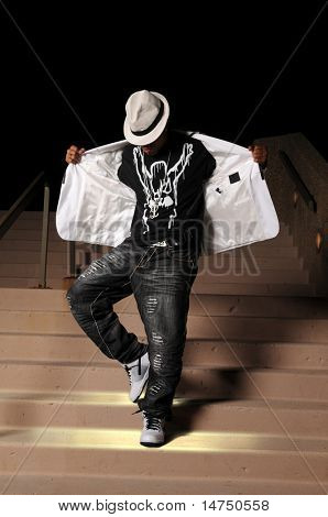 African American hip hop dancer performing on stairs