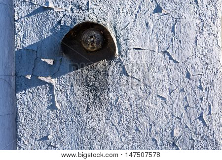 grunge cracked wall and tumbler switch