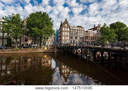 Amsterdam Netherlands - July 03 2016: The traditional Dutch houses on Singel street sunny morning