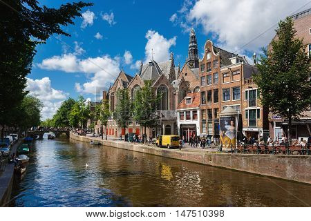 Amsterdam Netherlands - July 02 2016: The Oude Church the Calvinist church in the oldest district of the city sunny day