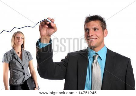 Businessman drawing growth chart on glass while woman looks