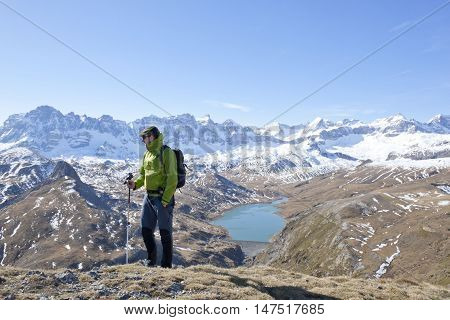 Hiker With A Pyrenean Lake As Background