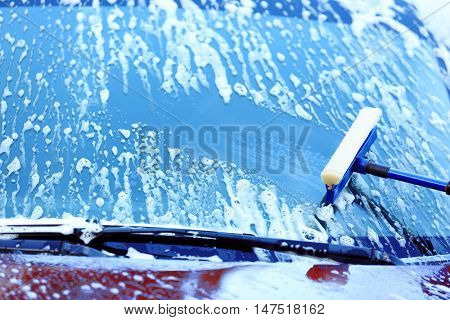Washing windscreen with window cleaner