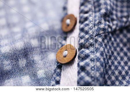 Buttons on shirt, close up