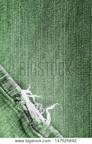 closeup of a frayed jeans texture for background