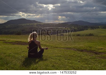 Woman Meditating In The Afternoon