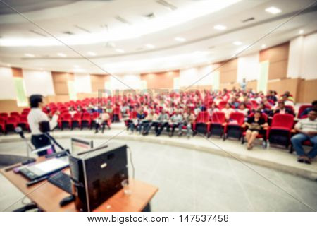 Abstract blurred background of university students in a large lecture room