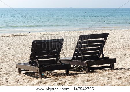 wooden beach chairs on beautiful island in white sand plage