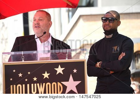 LOS ANGELES - SEP 07:  Usher and Harvey Weinstein arrives to the Walk of Fame honors Usher on September 07, 2016 in Hollywood, CA