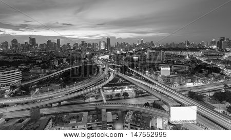 Black and White, Highway interchanged with city business downtown background