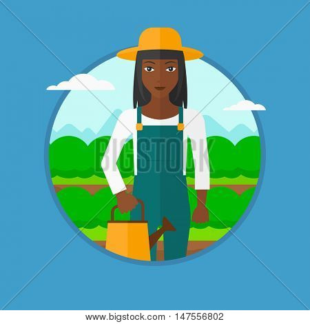 African-american farmer holding a watering can on the background of agricultural field with green bushes. Woman watering cabbage. Vector flat design illustration in the circle isolated on background.