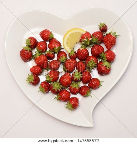 Heart Shaped Plate And Red Strawberry