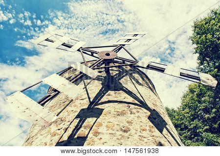 Old tower windmill in Holic Slovak republic.  Retro photo filter.