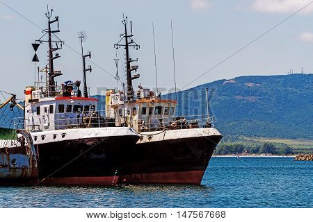 SOZOPOL, BULGARIA - JULY 16, 2016: Cutters moored in the port of Sozopol, one of the oldest Bulgarian towns, founded in the 7th century BC, nowadays one of the major seaside resorts in the country.