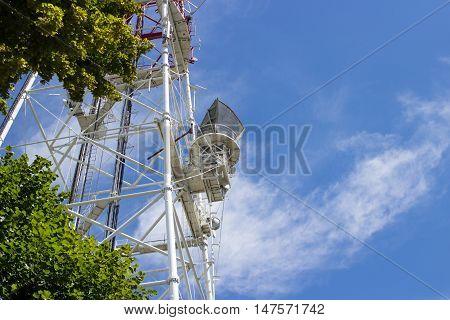 Telecommunication tower mast TV antennas wireless technology with blue sky