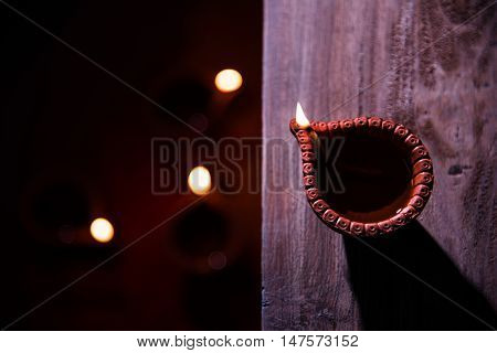 beautiful diwali diya with fire crackers and sweet pera, selective focus