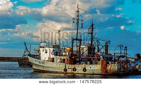 SOZOPOL, BULGARIA - JULY 18, 2016: Cutters moored in the port of Sozopol, one of the oldest Bulgarian towns founded in the 7th century BC, nowadays one of the major seaside resorts in the country.