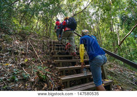 Semporna,Sabah-Sep 10,2016:Group of hikers on hiking trail,trekking in Bohey Dulang,Tun Sakaran Marine Park,Semporna,Sabah,Borneo.It is the most popular island for hiking & climbing activities.