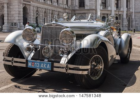 Vienna / Austria - July 20th 2014: Stutz 8 vintage car parked in front of Burgtheater building