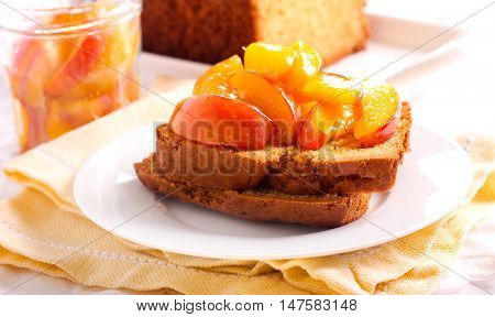 Cornmeal buttermilk loaf cake with syrupy peaches