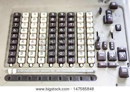 Number keyboard of an old machine, closeup