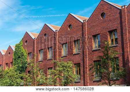 Serial houses made from red bricks seen in Berlin, Germany