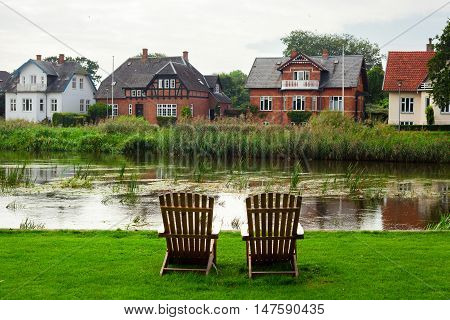 Two Wooden Armchairs Facing Ribe River Denmark