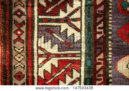 The sample with ethnic geometric patterns on the edge of ancient rug