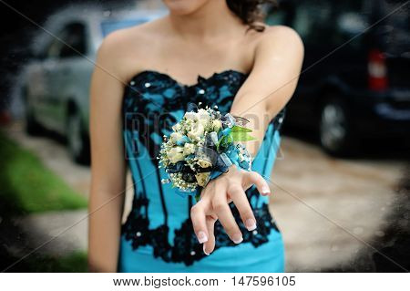 Pretty turquoise and black wrist corsage worn to the prom.